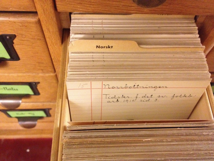 Notecards in a filing drawer: old-fashioned means of recording metadata.