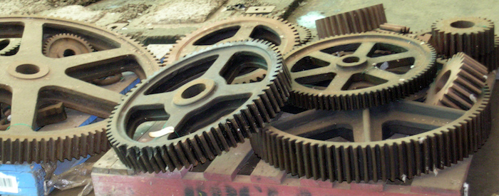 Gears laid out on a pallet.