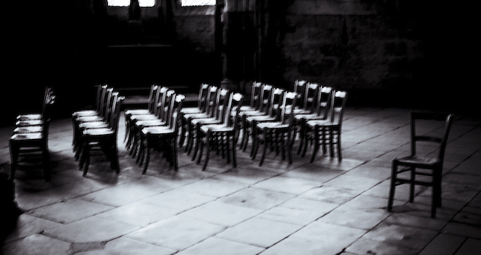 Rows and rows of empty chairs.