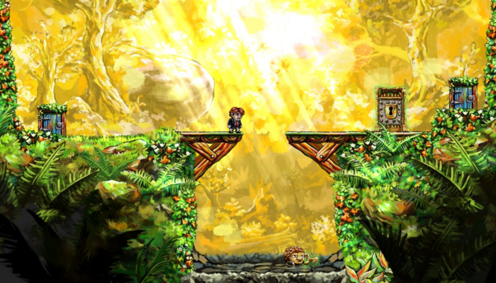 "From ""Braid"": The protagonist stands on a bridge over a chasm; the bridge has a large gap in it separating the character from a door with a large padlock on it. The scenery is lush, green and rich.: plants, trees and flowers."