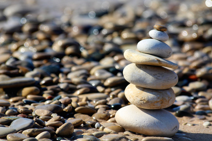 A stack of stones on a rocky beach.