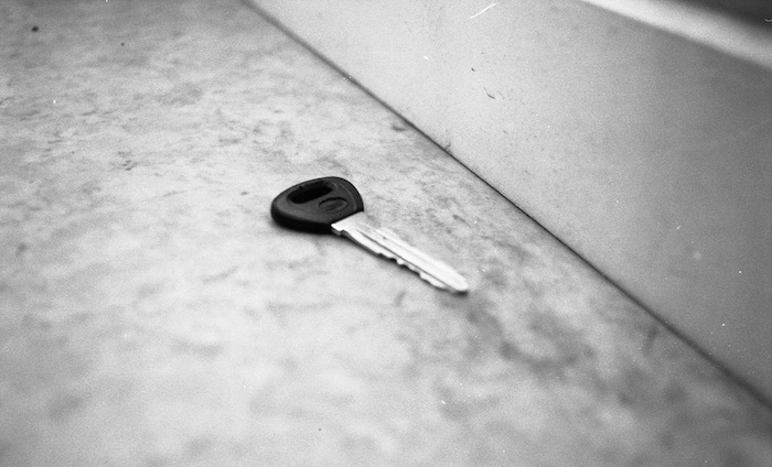 Key lost on a concrete floor.