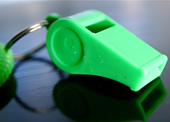 Bright green whistle.