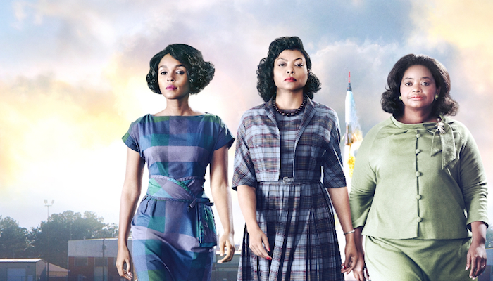 Promo photo for Hidden Figures: Taraji P. Henson, Octavia Spencer and Janelle Monáe looking confidently into the camera, a rocketship in the background.