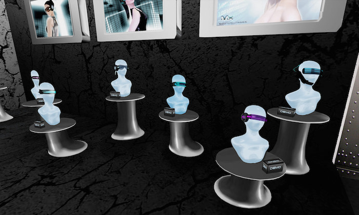Series of mannequin heads on pedestals with virtual reality headsets of various colors mounted over their eyes