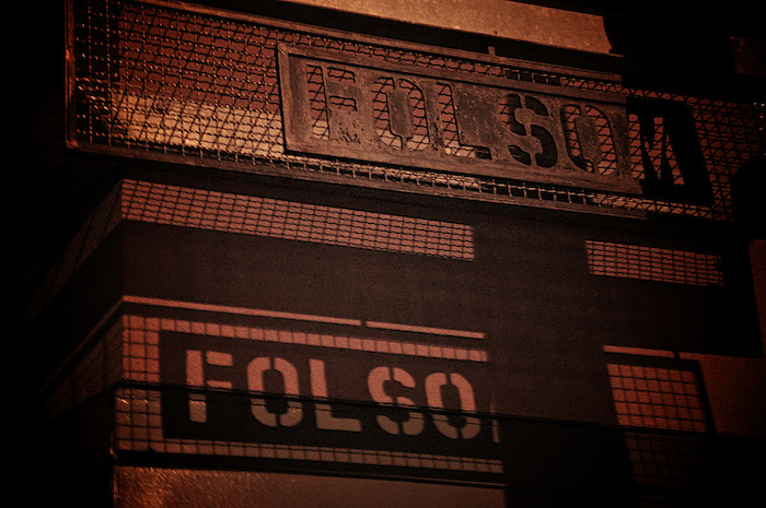 Grated sign that reads 'Folsom'.