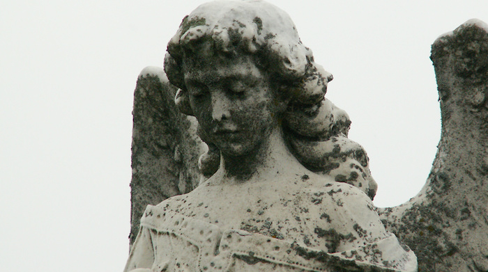 An angel statue in a cemetery.